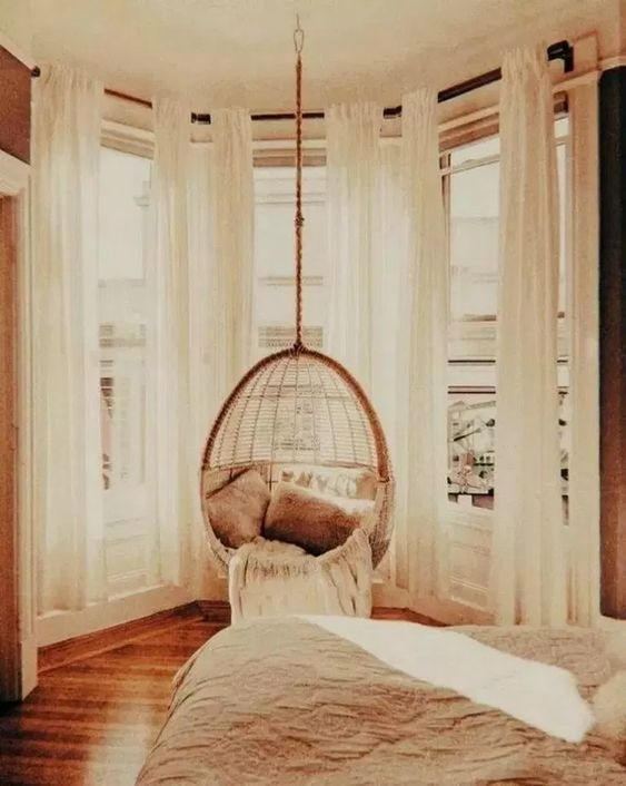 window bay, large glass window, wooden floor, rattan swing