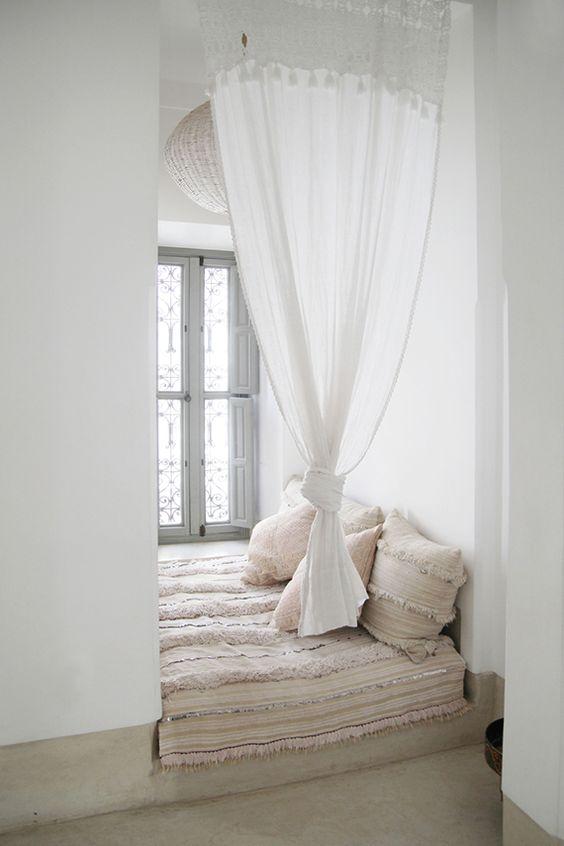 window, cream marble floor, white wall, white curtain, white cushion, pillows, glass window