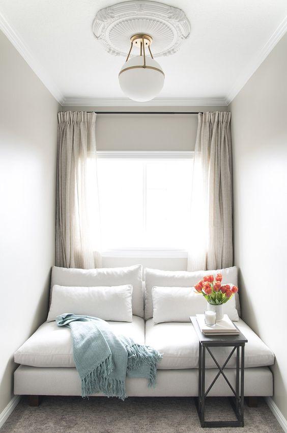 window cushion, grey floor, white wall, white sofa, white pillows, white pendant, white curtain
