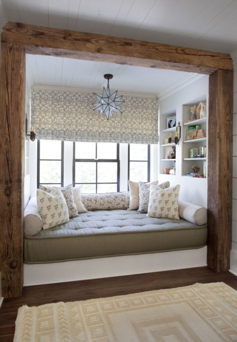 window, wooden floor, white wooden wall, wooden beams, white wall, white built in shelves, grey cushion, star pendant