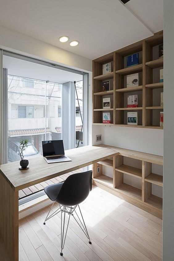 wooden built in study table, wooden shelves, in front of large glass window