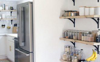 wooden floating shelves, white wall, wooden floor, white bottom cabinet white counter top, grey fridge