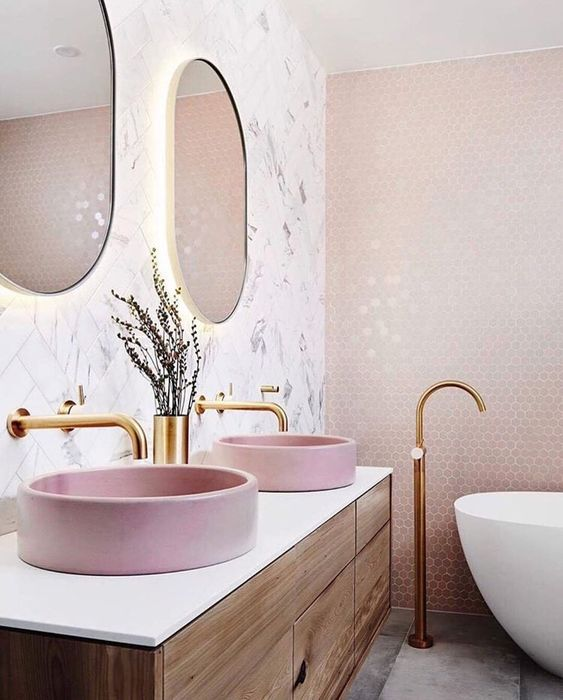 wooden vanity, white counter top, pink round sink, white marble wall, mirrors, pink hexagonal wall tiles