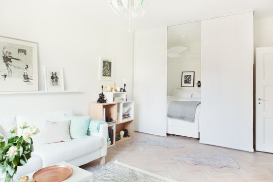 apartment, white wall, white floor, white sofa, white curtain, shelves, white chandelier