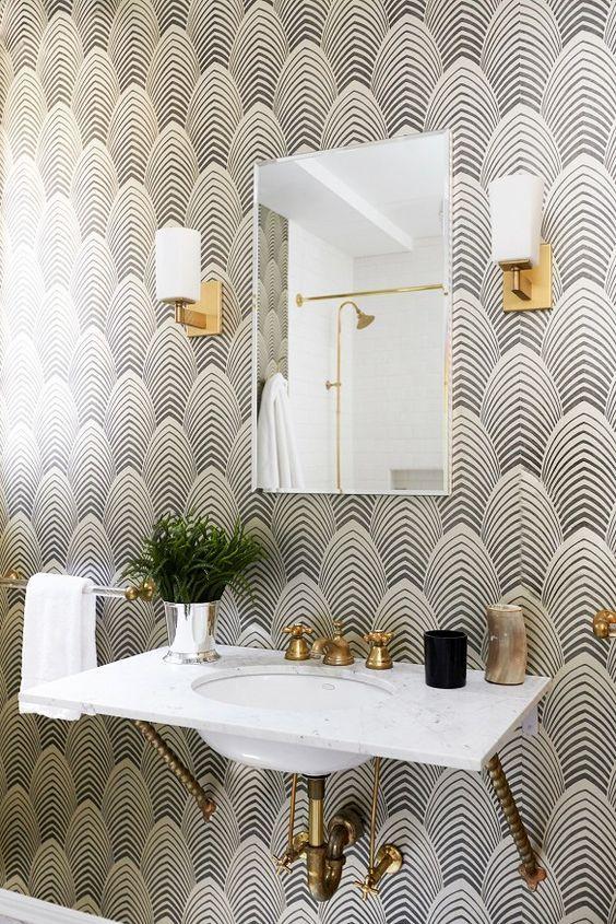 bathroom, black white geomterical lines wallpaper, sconces, white marble floating vanity, square miror