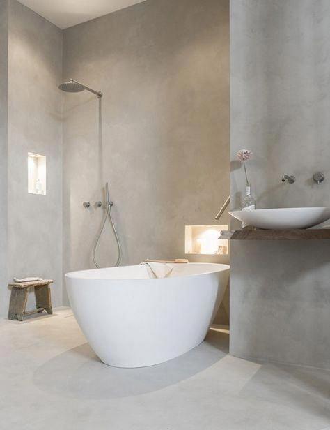 bathroom, grey floor, grey concrete wall, wooden floating vanity, white sink