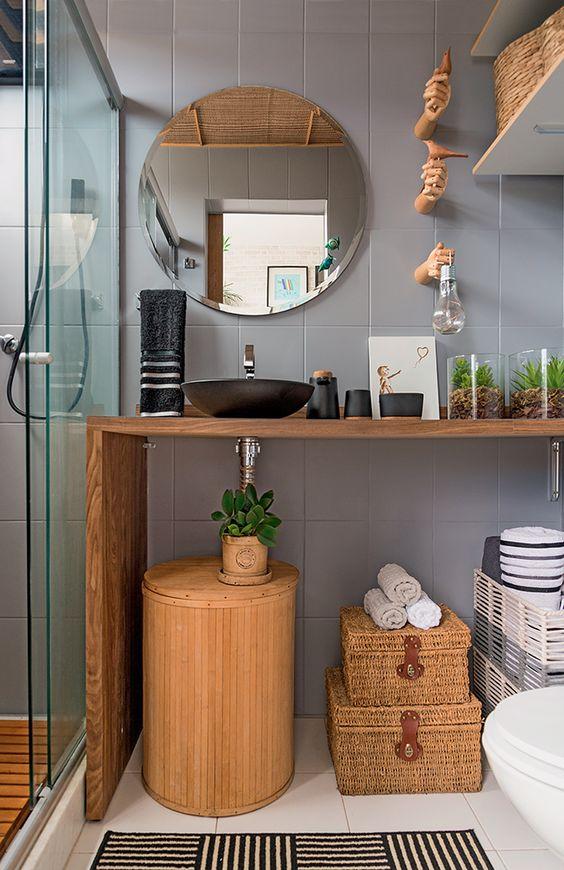 bathroom vanities, grey wall, wooden floor, white floor, wooden table, black round sink, white floor, white toilet, round mirror