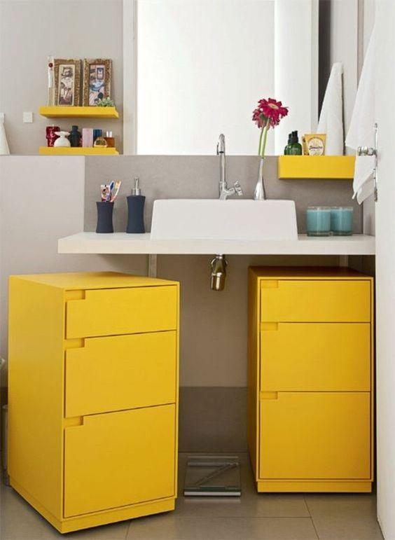 bathroom vanity, white counter top, yellow cabinet, grey floor, white wall, yellow shelves
