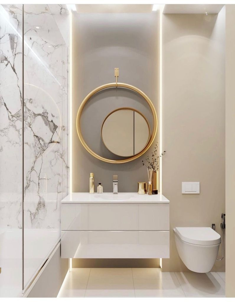 bathroom, white floor, white marble wall, white floating cabinet, white floating toilet, round mirror, round golden ring, grey wall