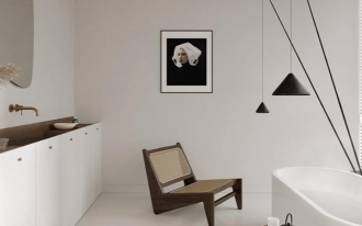 bathroom, white floor, white wall, black pendants, white tub, wooden side table, wooden chairs, white cabinet, vanity, mirror