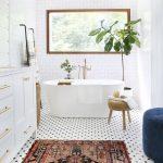 Bathroom, White Wall Floor, White Tiny Hexagonal Floor Tiles, Patterned Rug, White Cabinet, Rattan Stool, Blue Ottoman