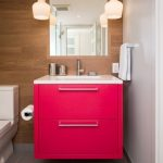 Bathroom, White Wall, Wooden Wall, Shocking Pink Floating Cabinet, White Counter Top, White Toilet, White Pendant