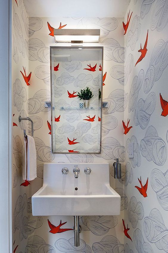 bathroom, white wallpaper with red bird, white floating sink, mirror