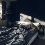Bedroom, Black Accent Wall, White Bed Platform Grey, White Side Table