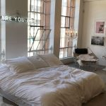 Bedroom, Concrete Floor, White Wall, Lounge Chair, White Bed, Glass Window