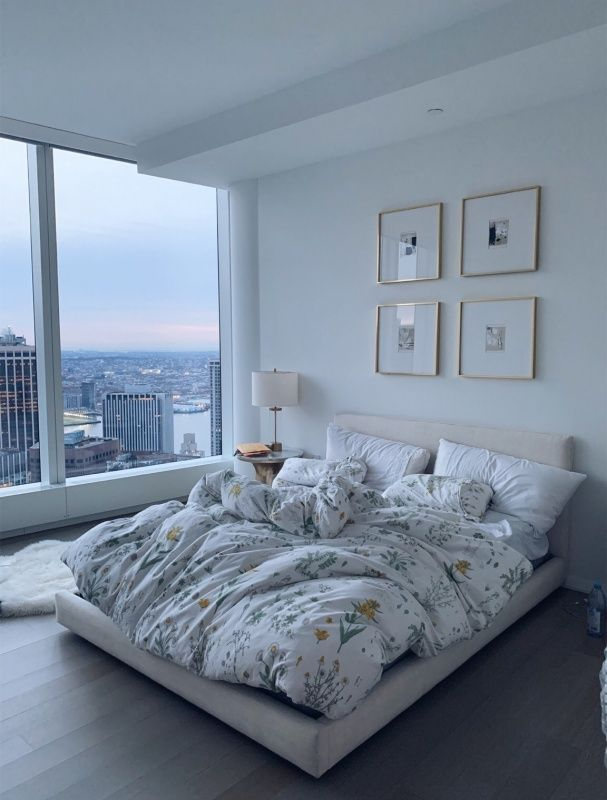 bedroom, glass window, white wal, white bed platform, white headboard, round side table, white table lamp