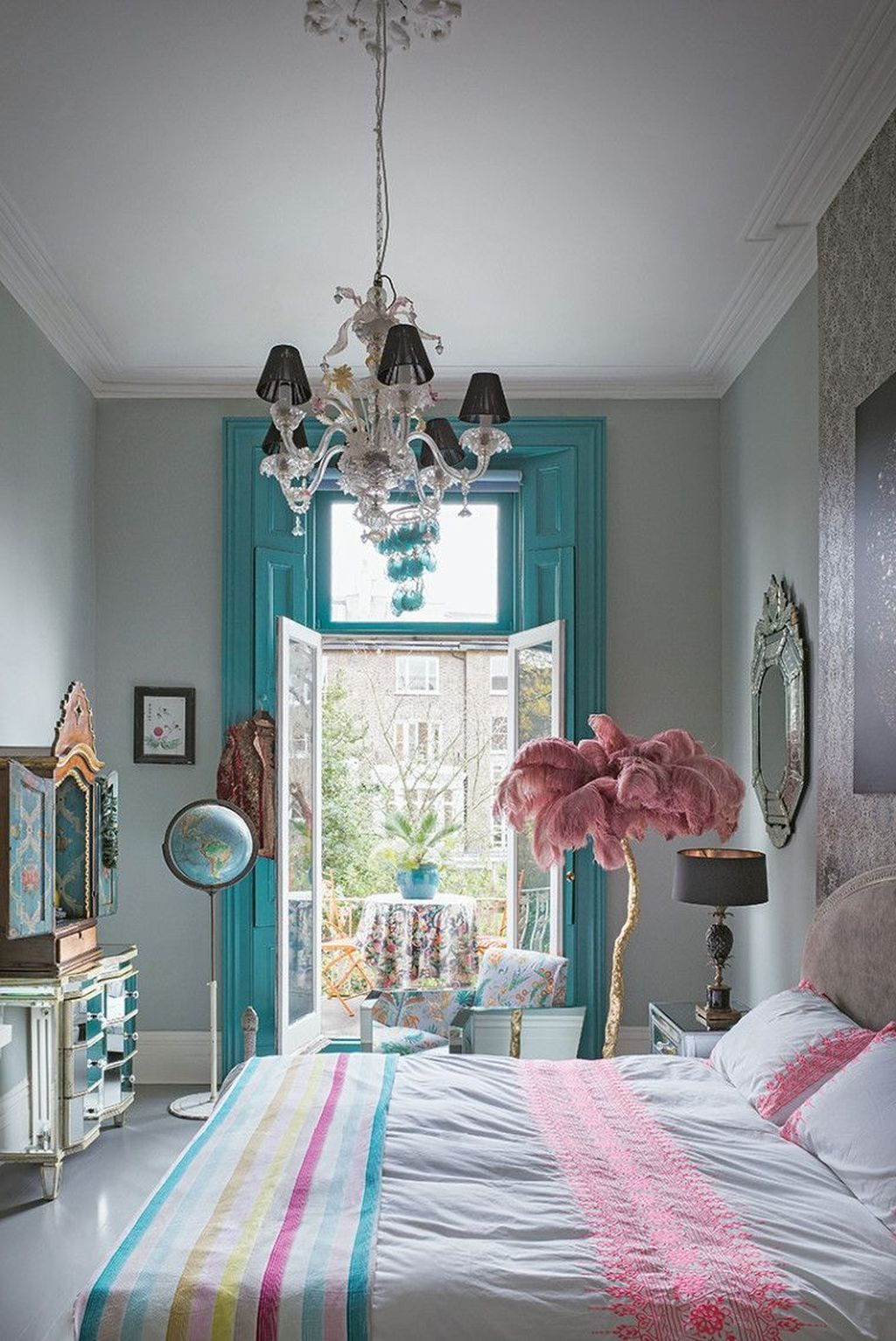 bedroom, white floor, light grey wall, glass cabinet, floery chair, acrylic side table, black table lamp, bed, chandelier