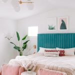 Bedroom, White Wall, Pink Chairs, Blue Velvet Headboard, Plants, White Bulbs Chandelier