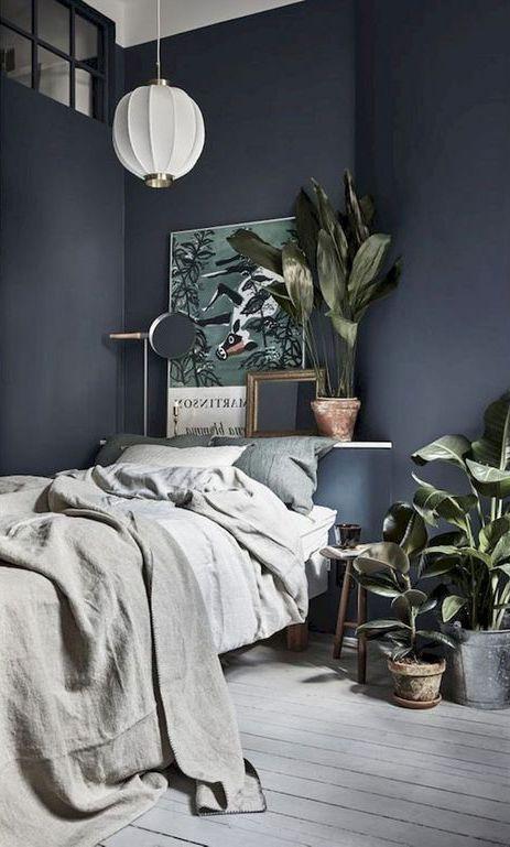 bedroom, wooden floor, grey wall, soft green bedding, mirror, shelves