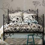 Black Metal Bed Frame, White Flowery Wallpaper, Grey Seamless Floor,