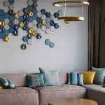 Bleu Golden Hexagonal Accent On The Wall, Brown Sofa
