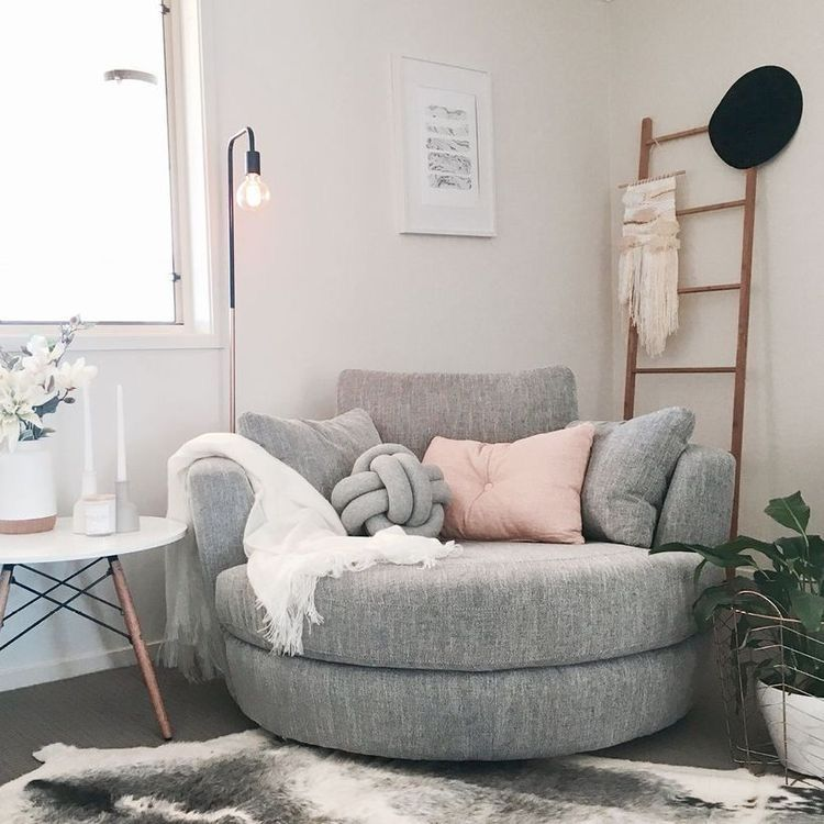 corner, big round grey chair, white side table, pillows