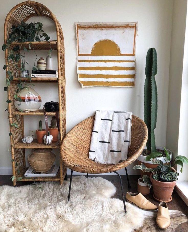 corner, black floor, white wall, rattan rond chair, white fur rug, rattan shelves
