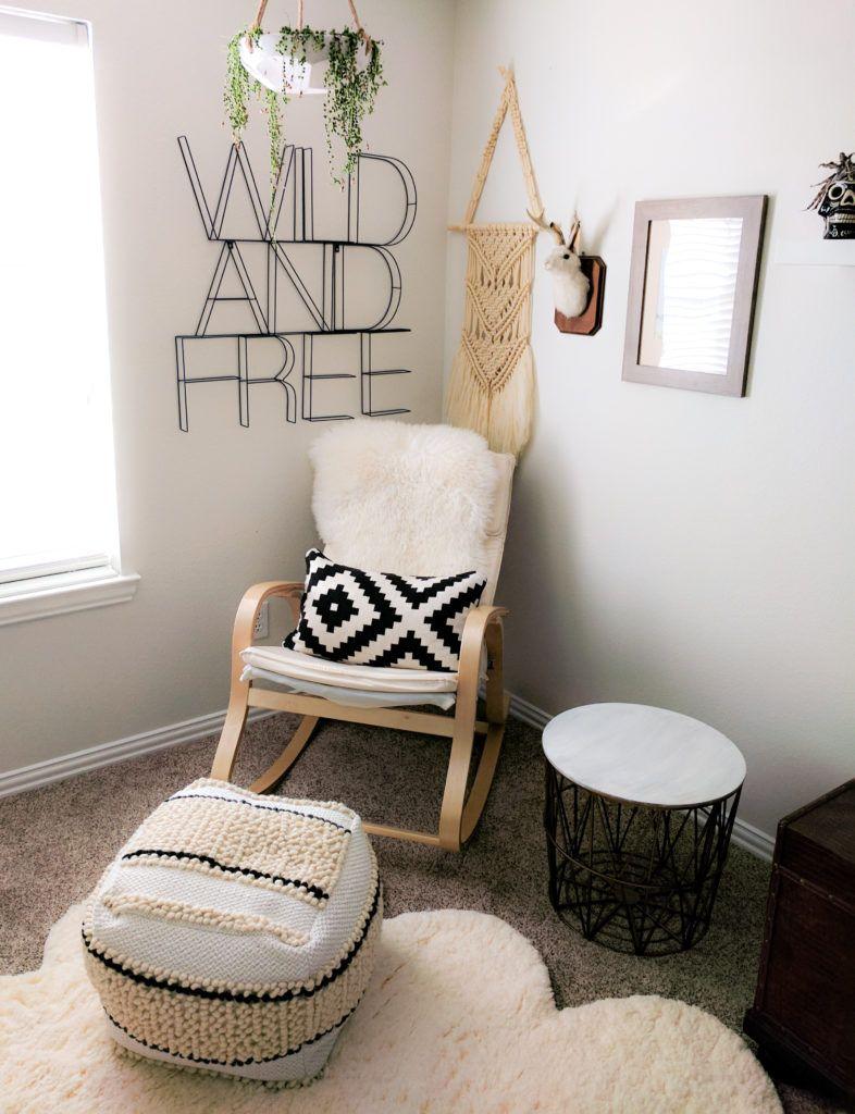 corner room, grey rug, white wall, rocking chair, white cushion, white ottoman, black metal stool
