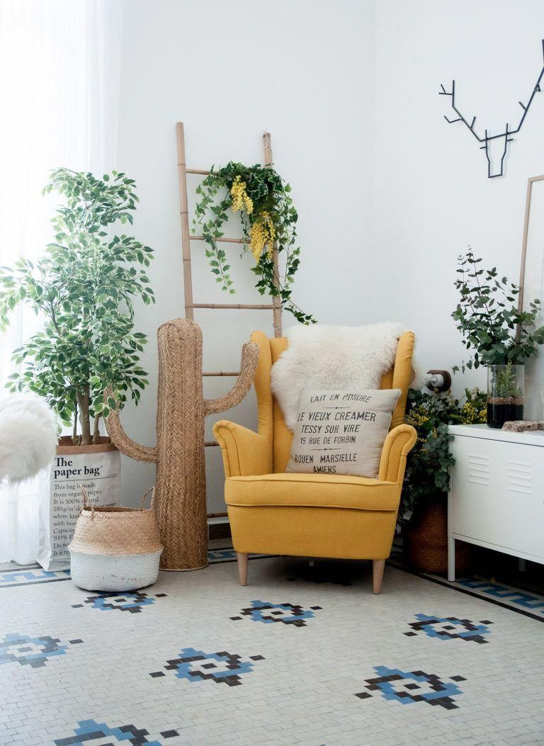 corner room, white patterned rug, yellow chair, white cabinet, wooden rack