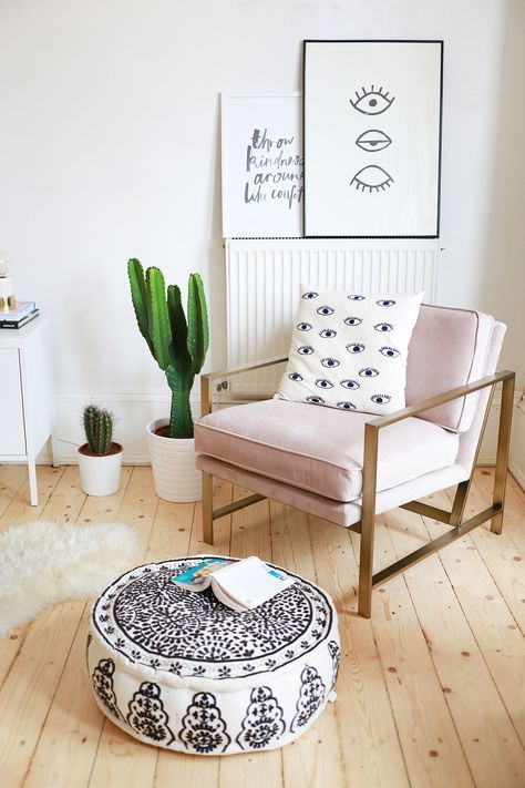 corner room, wooden floor, white wall, chair with golden, pink cushion, ottoman