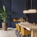 Diing Room, Wooden Floor, Dark Blue Wall, Crystal Pednant, Wooden Table, Yellow Chairs