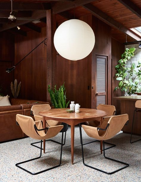 dining room, brown leather chair, wooden round table, grey tiles, white ball pendant