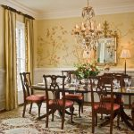 Dining Room, Patterned Rug, Yellow Wall, Flowery Pattern, Wainscoting, Chandelier, Wooden Chairs, Round Table