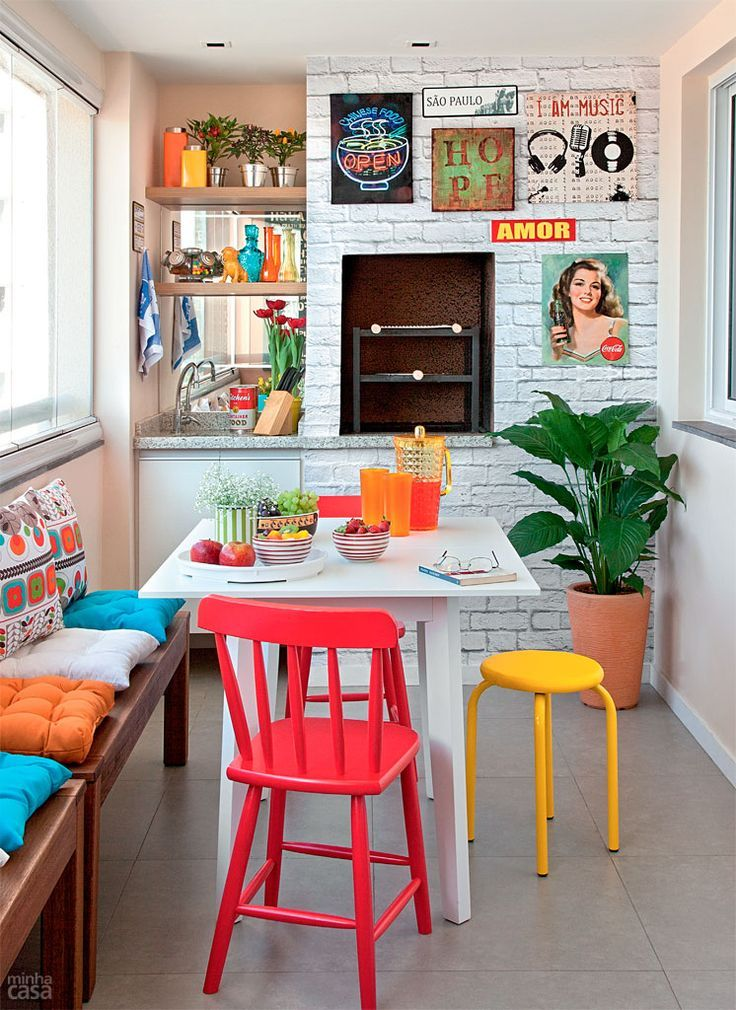 dining room, white exposed wall, white wall, grey floor tiles, white table, wooden bench, red wooden chair, yellow stool