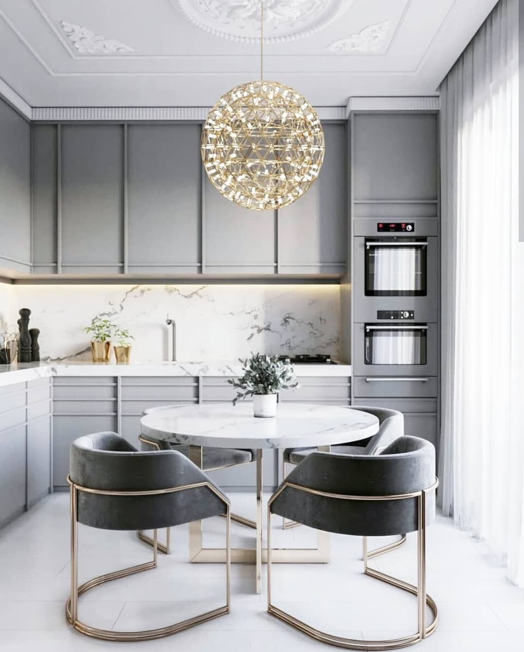 dining room, white seamless floor, white round marble table, grey chairs with golden lines, golden pendant, grey cabinet, white marble backsplash and countertop