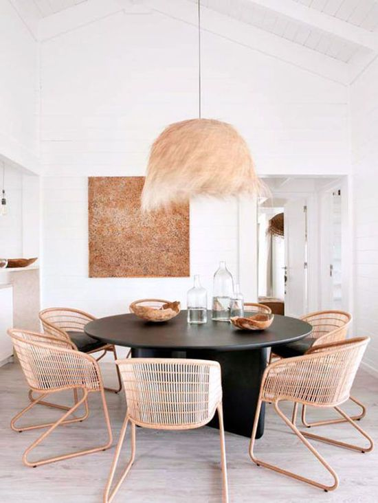 dining room, wooden floor, black round table, rattan chairs, rattan pendant, white planks wall