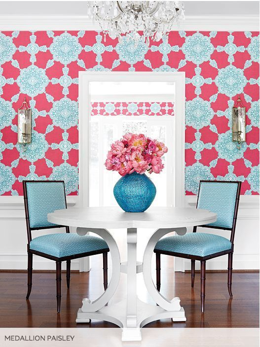 dining room, wooden floor, pink blue patterned wall, white round table, blue chairs