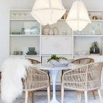 Dining Room, Wooden Floor, White Round Rug, White Round Marble Tulip Table, Rattan Chairs, White Pendants, White Shelves