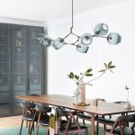 Dining Room, Wooden Floor, White Wall, Green Rug, Wooden Chairs, Wooden Table, Green Clear Chandelier