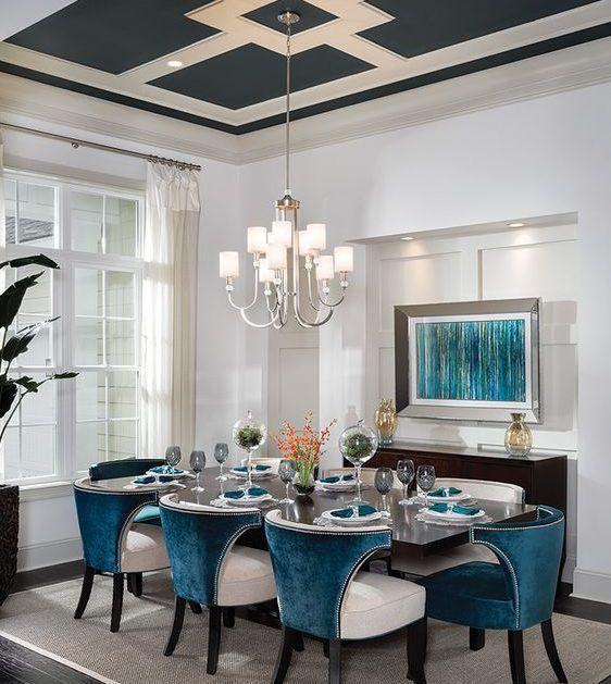 diningroom, white wall, rug, blue white chair, wooden table, white modern chandelier