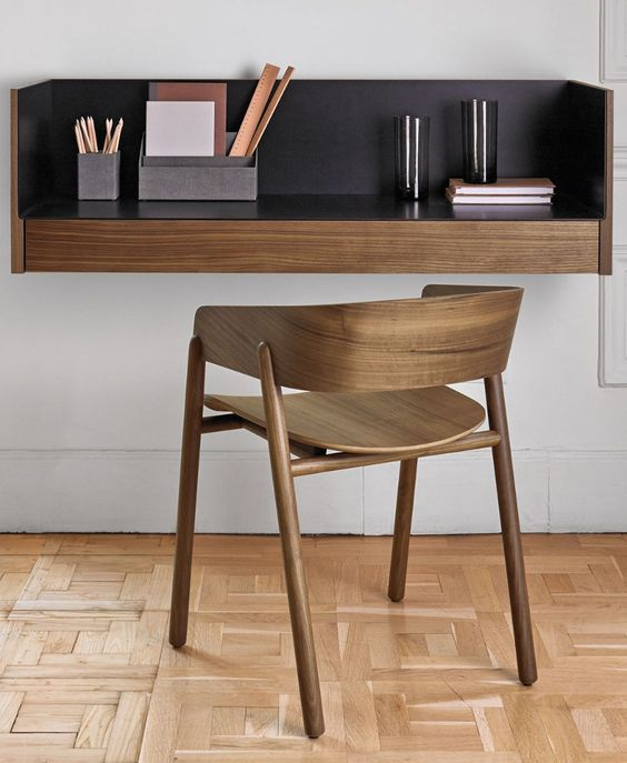 floating study table, black inside, wooden chair, white wall, wooden floor