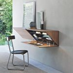 Floating Table, Wooden Material, Prism Shape, Opened Door, Grey Wall, Black Chair, Grey Flor, Grey Floor