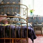 Golden Bed Frame, Wooden Floor, White Red Stripes Rug, Flowery Wallpaper, Wooden Side Table
