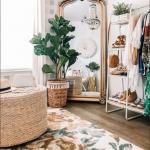 Golden Framed Mirror, White Wall, Wooden Floor, Rattan Ottoman, White Shelves, Rattan Plants Pot