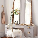Golden Large Framed Mirror, On The Grey Wooden Make Up Table, Wooden Floor, Golden Lined Chair