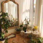Golden Line Framed Mirror, White Marble Round Table, Wooden Floor