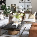 Grey Rug, Grey Sofa, Wooden Chairs With White Cushion, Brown Leather Ottoman, Black Tufted Ottoman