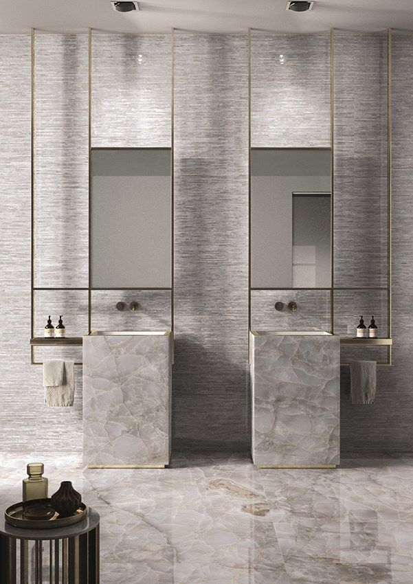 grey vertical marble vanity with indented sink, grey wall, rectangular mirrors with golden frame, marble floor