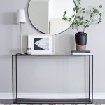 Hallway, White Wall, Black Lined Console Table, Black Floor, Patterned Floor, White Table Lamp, Round Mirror