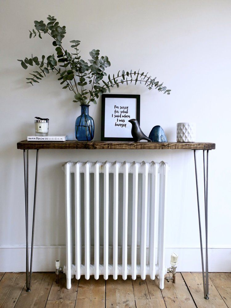 hallway, white wall, wooden floor, narrow and thin wooden console table with iron legs